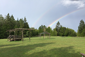 Pow Wow grounds at Straits State Park pictured with a rainbow in the sky