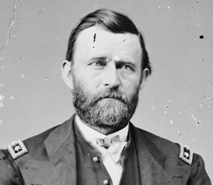 Black and white headshot of a bearded man in uniform.